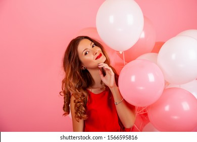 happy girl with balloons. color background, copy space.