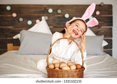 Happy girl with a basket of eggs