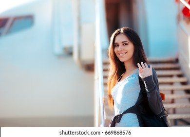 Happy Girl  Boarding  Airplane and Waving Goodbye - Woman standing on the boarding stairs of a plane