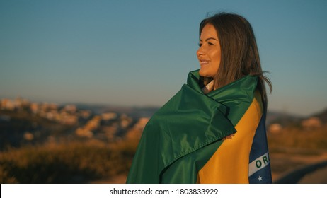 Happy girl with Brazil flag, independence day