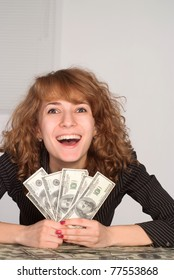 happy girl with a cash at the table