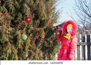 happy girl with Christmas tree outdoor