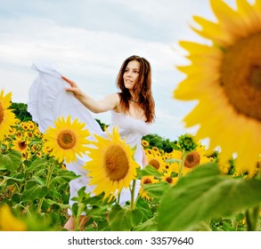 happy girl  dancing in the field of sunflowers