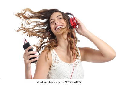 Happy girl dancing and listening to the music isolated on a white background