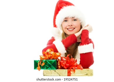 happy girl dressed as Santa with Christmas presents