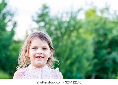 Happy girl excited. Young girl smiling very happy surprised  being amazed on green background. Cute little girl looking at camera. Closeup portrait with shallow depth of field.