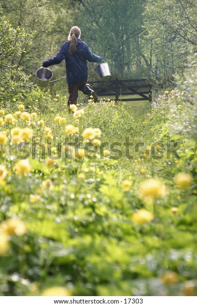 A happy girl fetching skipping through a flower field.