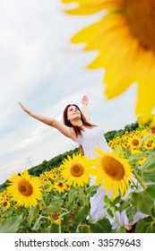 happy girl in the field of sunflowers