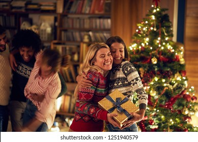 happy girl gay couple in love with Christmas present