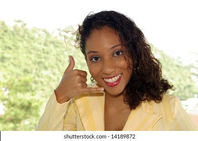 happy girl giving the please call me sign