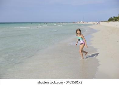 Happy girl has fun in the Caribbean sea.