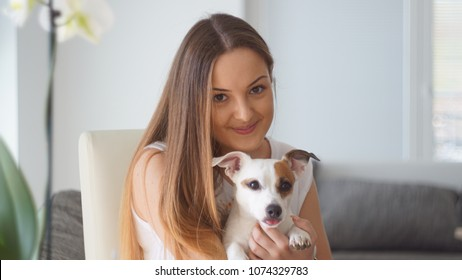 Happy girl with her dog.