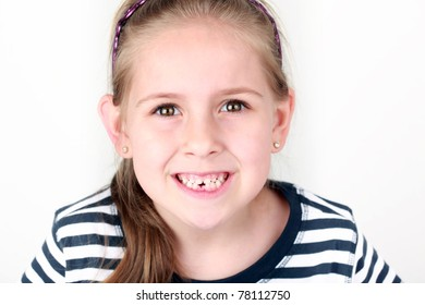 Happy girl with her first missing tooth