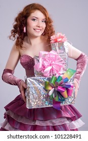 Happy girl holding gift boxes
