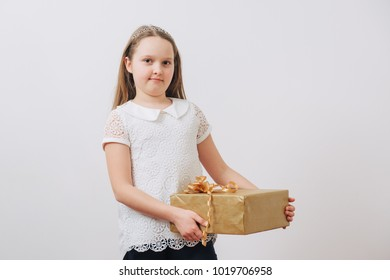 Happy girl holding her presents on birthday on white background.Mother`s day.