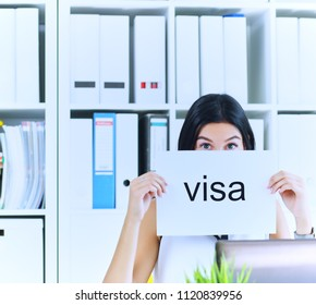 Happy girl holding a poster with the inscription visa. Young girl received a work visa in the United States. Girl received a visa to continue her studies abroad.