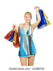 Happy girl holding shopping bags. Isolated over a white background