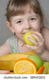 happy girl hugging favorite fresh fruit