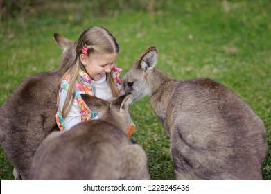 Happy girl with kangaroo. Wildlife