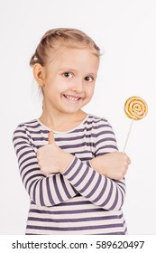 Happy girl with lollipop. image on a white studio background.