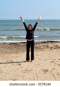 happy girl making poses on the beach