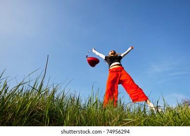Happy girl on grassland