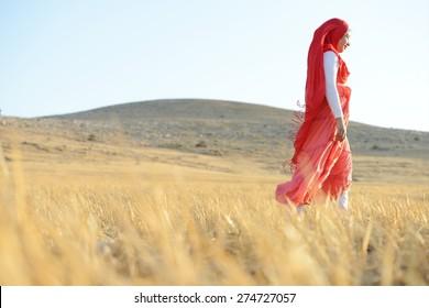 Happy girl on meadow