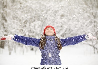 happy girl on a walk in the winter. teen outdoors enjoying snow