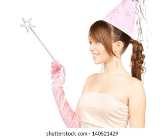 happy girl in party cap with magic stick