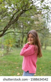 Happy girl in pink sweater
