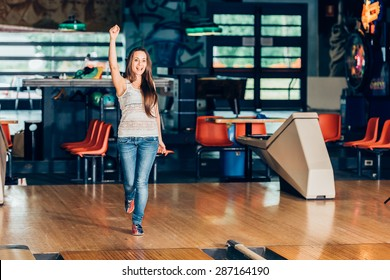 happy girl playing bowling