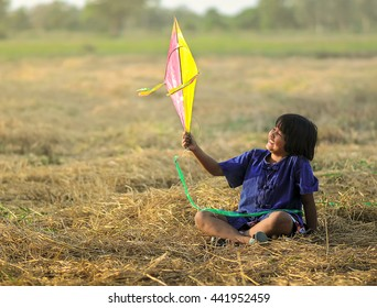 happy girl playing and dreams outdoors  . Imagination of a young girl into the world