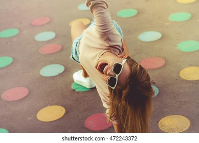 Happy girl playing twister game outdoor