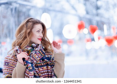 Happy girl portrait on the street. Model wearing stylish warm clothes. City lifestyle. winter portrait in the park