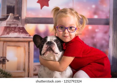 Happy girl posing with her dog in christmas scenery