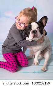 Happy girl posing with lovely french bulldog