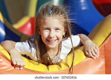 Happy girl relaxing and having fun in a summer park