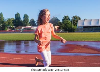 Happy girl run on the track