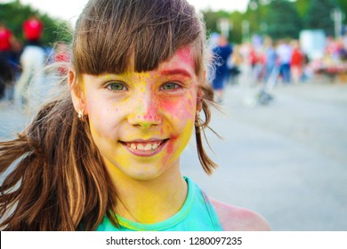 Happy girl shows class with holi paint.