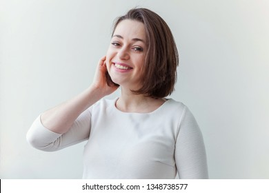 Happy girl smiling. Beauty portrait young happy positive laughing brunette woman on white background isolated. European woman. Positive human emotion facial expression body language
