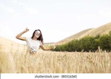 Happy girl smiling in field