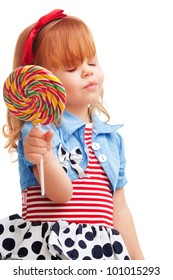 Happy girl smiling and holding lollipop, with closed eyes isolated on white background