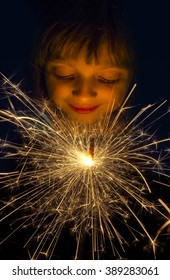 happy girl with a sparkler
