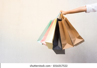 Happy girl spend her free time shopping. Buy gifts for lover and family on the special day.
