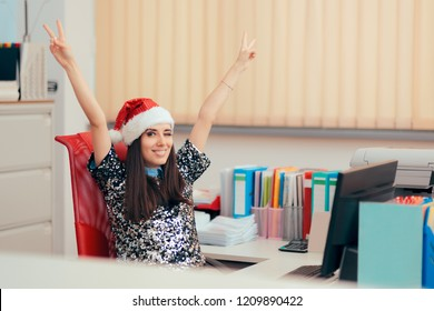 Happy Girl Spending Christmas Holiday at the Office. Cheerful  woman spending Xmas at her workplace