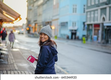 A happy girl in the streets of denmark