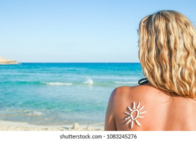 happy girl with the sun on her back by the sea in the nature