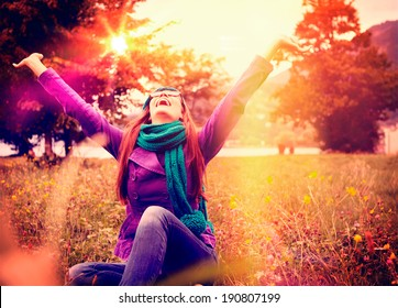 happy girl in sunset in a meadow