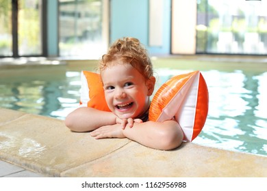 A Happy Girl in a Swimming Pool with wings