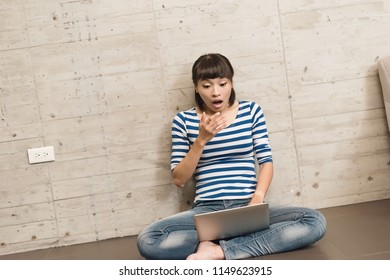 happy girl use a laptop at home, concept of working in the house